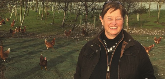 Anne Fleck with poultry & iPad